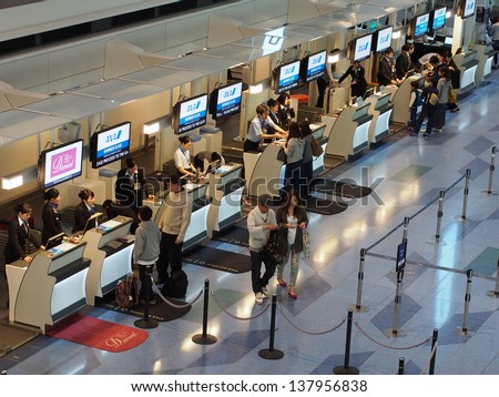 TOKYO -MAY 3: Check in counter at Tokyo International Airport, Japan on May 3, 2013. Tokyo International Airport is one of the two primary airports that serve the Greater Tokyo Area in Japan. - stock photo