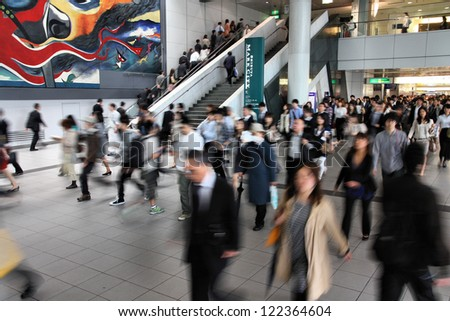TOKYO - MAY 9: Commuters hurry at Tokyo Shibuya station on May 9, 2012 in Tokyo. With 2.4 million passengers on a weekday, it is the 4th-busiest commuter rail station in Japan. - stock photo