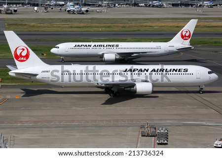 TOKYO - MAY 22: Japan Airlines Boeing 767 on May 22, 2014 in Tokyo. Japan Airlines is the second largest airline in Japan with its headquarters in Tokyo. - stock photo