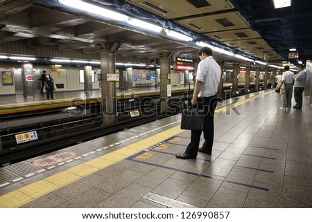 TOKYO - MAY 8: People wait for Tokyo Metro on May 8, 2012 in Tokyo, Japan. With more than 3.1 billion annual passenger rides, Tokyo subway system is the busiest worldwide.