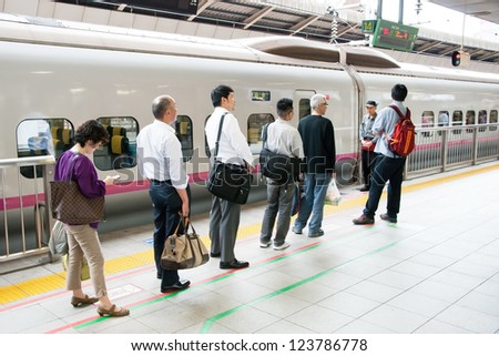 TOKYO - MAY 20, 2012: People waiting for shinkansen bullet train at Tokyo main railway station in May 20, 2012 Tokyo, Japan.Shinkansen is world's busiest high-speed railway on the world. - stock photo