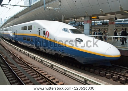 TOKYO - MAY 17, 2012: Shinkansen bullet train at Tokyo railway station in May 17, 2012 Tokyo, Japan. Shinkansen is world's busiest high-speed railway operated by four Japan Railways companies. - stock photo
