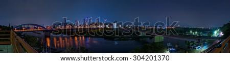 Tokyo metropolitan night view seen from the riverside (Panorama) - stock photo