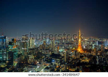 TOKYO - NOV 06: The Tokyo Tower lights up the skyline on November 06, 2015 in Minato Ward in Tokyo, Japan. With over 35 million people, Tokyo is the most populated metropolitan area in the world.