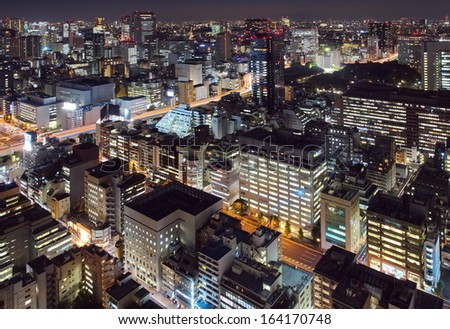TOKYO - Nov 18: With over 35 million people, Tokyo is the world's most populous metropolis and is described as one of the three command centers for world economy Nov 18,2013 in Tokyo, Japan  - stock photo