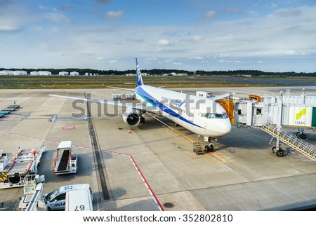 TOKYO - OCT 29: ANA aircraft at Narita Airport on Oct 29, 2015 in Tokyo. ANA is one of largest airlines of Japan with 177 passenger planes.