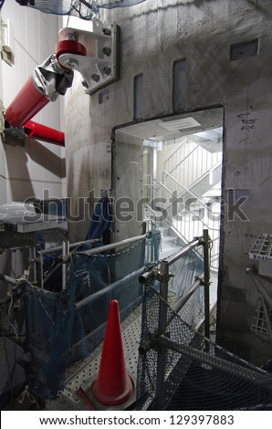 TOKYO - OCT 30: Red shock-absorbing plates attach to the center column, which acts as a counterweight for earthquakes and wind, of the nearly completed Tokyo Skytree in Tokyo, Japan, Saturday, October 30, 2011.