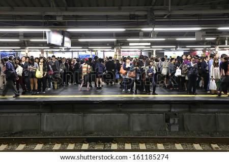 TOKYO -OCT 21 : rush hour at the  Shinjuku train station on 21 October 2013. Shinjuku is one of  the important  district with one of the biggest train station  in Japan. - stock photo