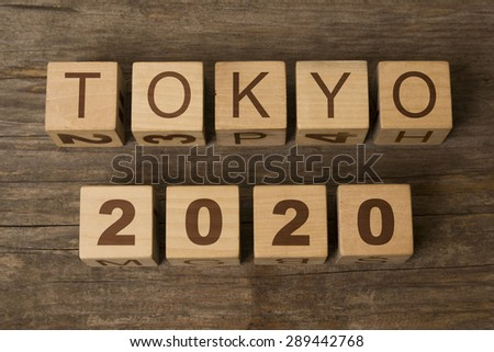 tokyo 2020 on a wooden background - stock photo