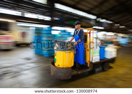 TOKYO-SEPT20:Pan of a motor cart speeding through the Tsukiji Fish Market in Tokyo on Sept. 20,2009. It's the biggest wholesale fish market in the world, where a single tuna for sushi can go for $746K - stock photo