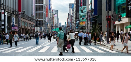 TOKYO-SEPT 20: The upscale Ginza district in Tokyo, Japan on Sept. 20, 2009. The famous Chuo Dori closes to cars on Sundays and becomes a pedestrian street to encourage shopping.