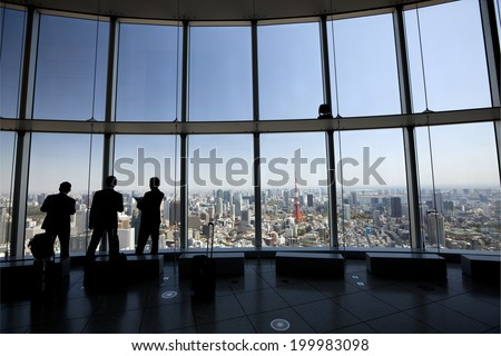 Tokyo sky View /View from the top. Tourists looking out on the city of Tokyo in Japan. - stock photo