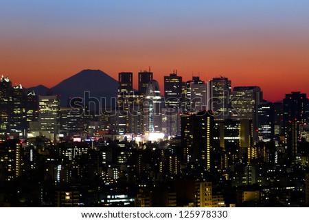 Tokyo skyline and Mount Fuji at sunset - stock photo