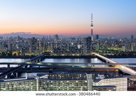 Tokyo Skyline at dusk, view of Asakusa district and the Sumida River. Skytree visible in the distance. - stock photo