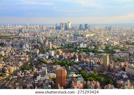 Tokyo skyline - city aerial view with Toshima and Shinjuku wards. Warm sunset light.