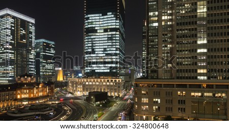 Tokyo station and cityscape with tall office buildings at night - stock photo