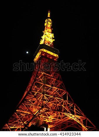 Tokyo tower at night as seen from the ground