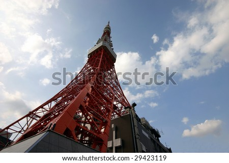 Tokyo Tower from below against cloudy sky