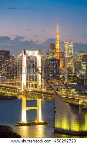 Tokyo Tower skyline and Rainbow Bridge with cityscape at Odaiba Japan  - stock photo