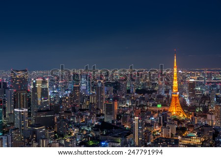 Tokyo Tower stands out among the Tokyo cityscape as dusk falls over Japan. - stock photo