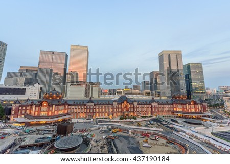 TOKYO TRAIN STATION - TOKYO - JAPAN - 11 JUN 2016 : Tokyo Station Brick Building and Surrounding Area During Twilight Evening. Tokyo Station is one of the oldest and crowded stations in Japan - stock photo