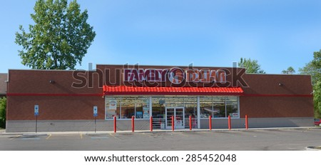 TOLEDO, OH - JUNE 2, 2015:  Family Dollar, whose west Toledo location is shown on June 2, 2015, has over 8,000 stores.  - stock photo