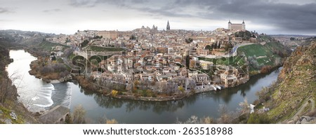 Toledo panoramic view at sunset with Tajo river in Spain. Horizontal - stock photo
