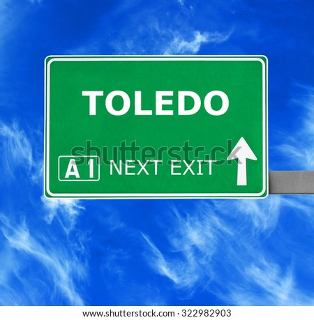 TOLEDO road sign against clear blue sky