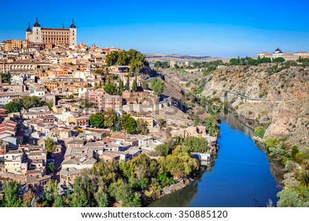 Toledo, Spain. Alcazar and the ancient city on a hill over the Tagus River, Castilla la Mancha medieval attraction of Espana. - stock photo