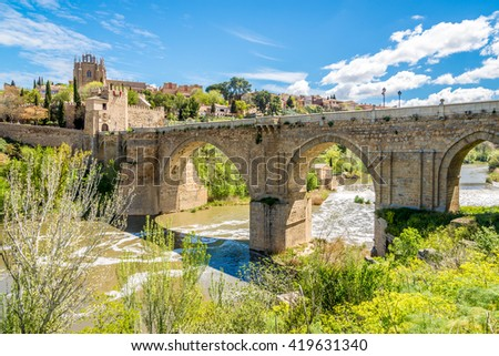 TOLEDO,SPAIN - APRIL 23,2016 - Bridge San Martin over river Tajo in Toledo. Toledo is a municipality located in central Spain.