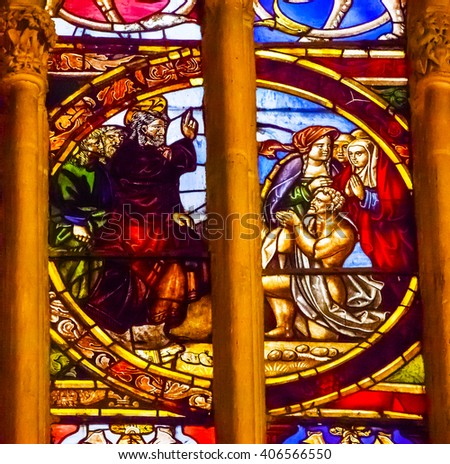 TOLEDO, SPAIN - MAY 16, 2014 Jesus Blessing Lazarus Stained Glass Cathedral Spanish Flag Toledo Spain.  Cathedral started in 1226 finished 1493 - stock photo