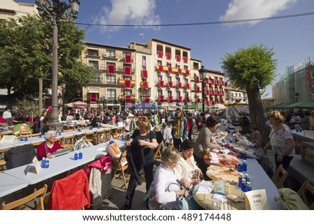 Toledo, Spain - May 28, 2016: Local women hold a market for handicrafts in the Plaza de Zocodover city square in Toledo, Spain on May 28, 2016