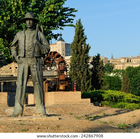 Toledo, Spain -  May 10, 2014: modern monument to Agricultor with a spud.