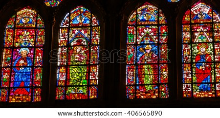 TOLEDO, SPAIN - MAY 16, 2014 Rose Window Coat Arms Cardinal Hat Stained Glass Cathedral Spanish Flag Toledo Spain.  Cathedral started in 1226 finished 1493 - stock photo
