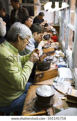Toledo, Spain- November 04, 2015: Artisan jewelers creating hand made jewelry items in a workshop.