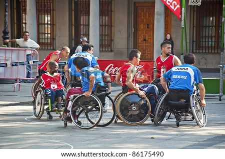 TOLEDO, SPAIN-OCTOBER 1: unidentified people play a friendly game of wheelchair basketball, one of the activities in the Youth Week on October 1, 2011 in Toledo, Spain