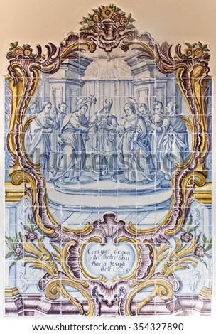 TOLEDO, SPAIN - SEPTEMBER 6 2015: 18th century Panel of Portuguese Tiles in the Museum of Santa Cruz, on September 6, 2015, in Toledo, Spain - stock photo