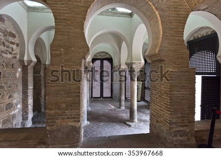TOLEDO, SPAIN - SEPTEMBER 5 2015: View of the main hall of the Mosque of Cristo de la Luz with its 4 columns capped with Visigothic capitals, on September 5, 2015, in Toledo, Spain - stock photo