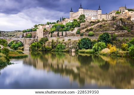 Toledo, Spain town skyline on the Tagus River. - stock photo