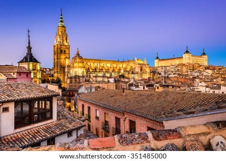 Toledo, Spain. Twilight view of ancient city Toledo in Castilla la Mancha with Santa Iglesia Catedral and Alcazar, landmark of Spain. - stock photo