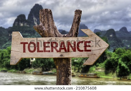 Tolerance wooden sign on a forest background  - stock photo