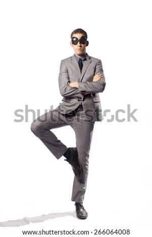 Toll man in gray suit stay like mannequin on white background - stock photo