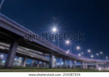 tollway express road with grass lawn in night scene - stock photo