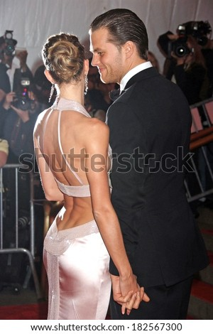 Tom Brady, in a Tom Ford suit, Gisele Bundchen, in a Versace gown, at Superheroes Fashion and Fantasy Gala, Metropolitan Museum of Art Costume Institute, New York, May 05, 2008 - stock photo