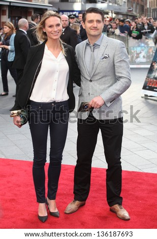 Tom Chambers and Clare Harding arriving for the Iron Man 3 Premiere, Odeon Leicester Square, London. 18/04/2013 Picture by: Alexandra Glen