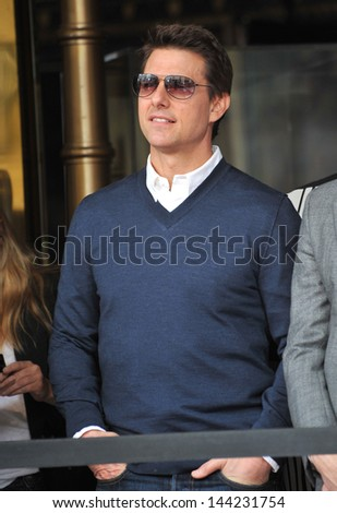 Tom Cruise on Hollywood Boulevard where Jerry Bruckheimer was honored with the 2,501st star on the Hollywood Walk of Fame. June 24, 2013  Los Angeles, CA - stock photo