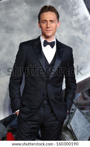 "Tom Hiddleston arriving for the world premiere of ""Thor: The Dark World"" at the Odeon Leicester Square, London. 22/10/2013 - stock photo"