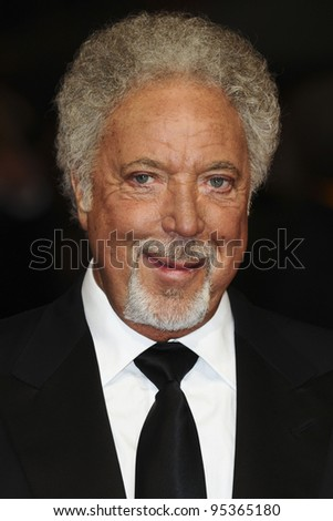 Tom Jones arriving for the BAFTA Film Awards 2012 at the Royal Opera House, Covent Garden, London. 12/02/2012  Picture by: Steve Vas / Featureflash - stock photo