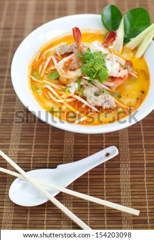Tom Yam Koong soup with noodles  - stock photo