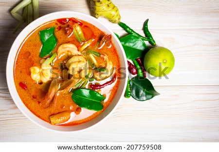Tom Yam Kung, Spicy Thai food on wood background, Top view  - stock photo